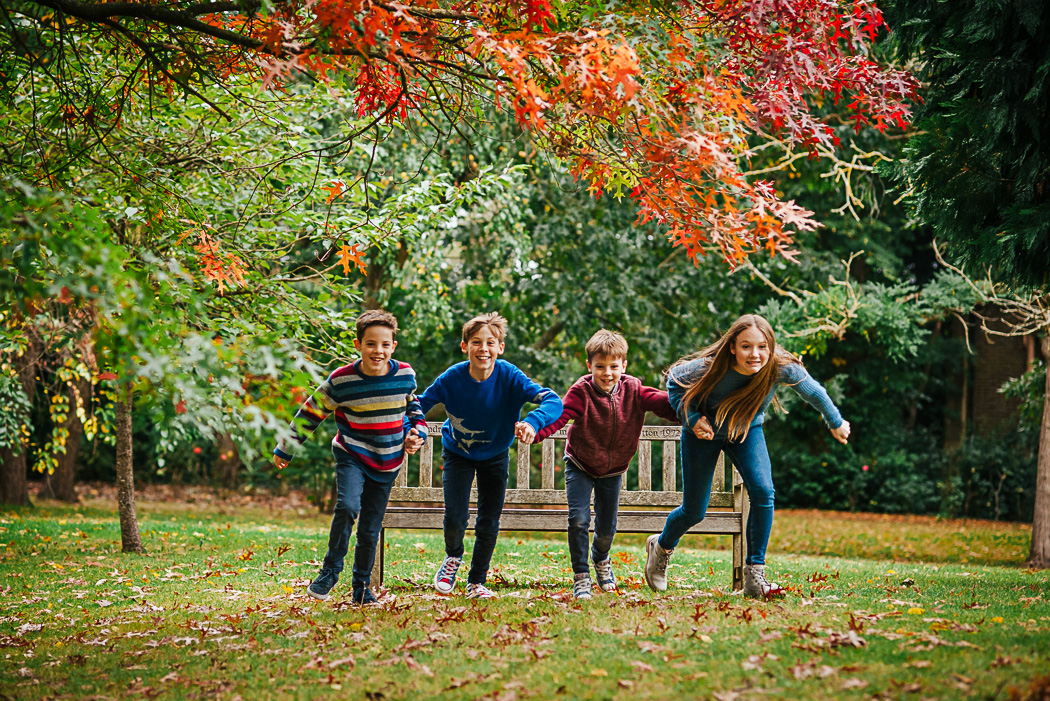Children playing on a family photoshoot in Surrey