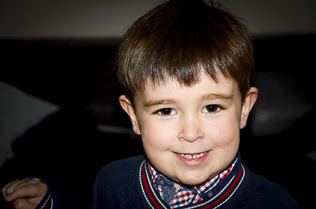 Little boy with a cheesy grin