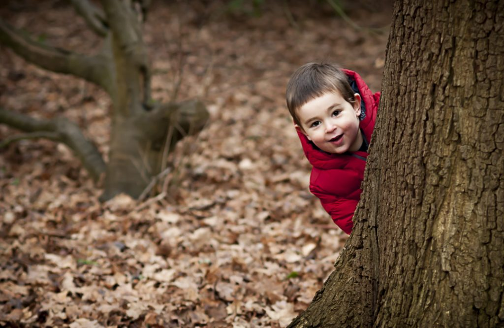 Kingston Family Photographer_hide and seek on a natural family photoshoot