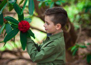 Young man enjoying spring flowers at Virigina Waters