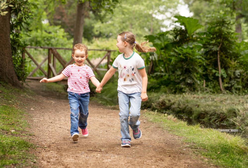 Girls having fun on family photoshoot in Surrey