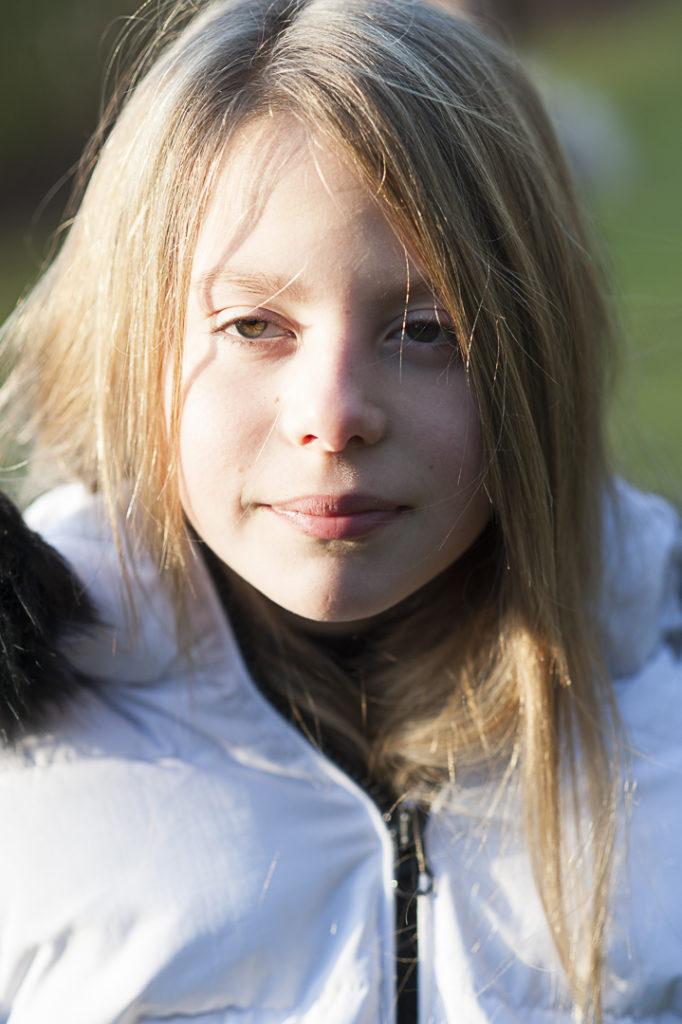 Girl stood in direct sunlight